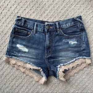 Free People jean shorts with lace detail
